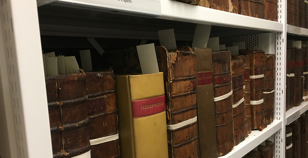 Archival storage shelfs at University of Edinburgh holding Session Papers